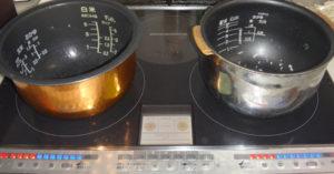 炊飯器の内釜をIHで加熱して熱伝導を比較している様子